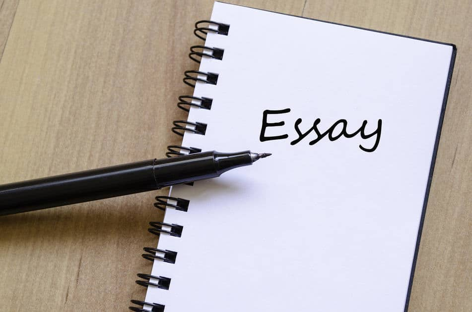 Image of a notepad with the word essay written on it