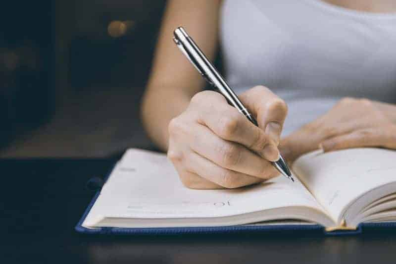 Woman writing in a notebook - FCE Writing