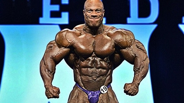 Phil Heath performing at a bodybuilding show.